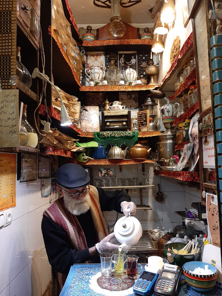 world's smallest tea shop tehran man pouring tea