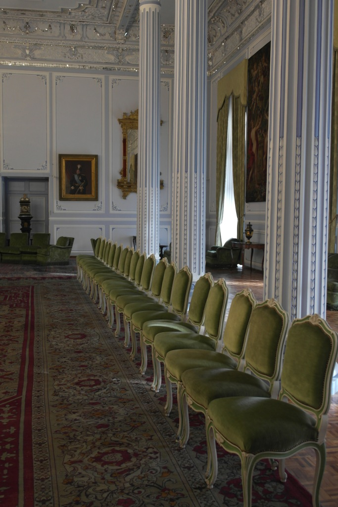 green chairs in line palace