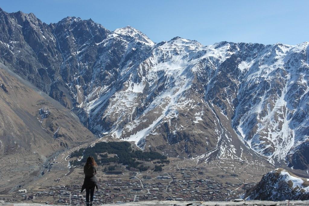girl mountains kazbegi georgia