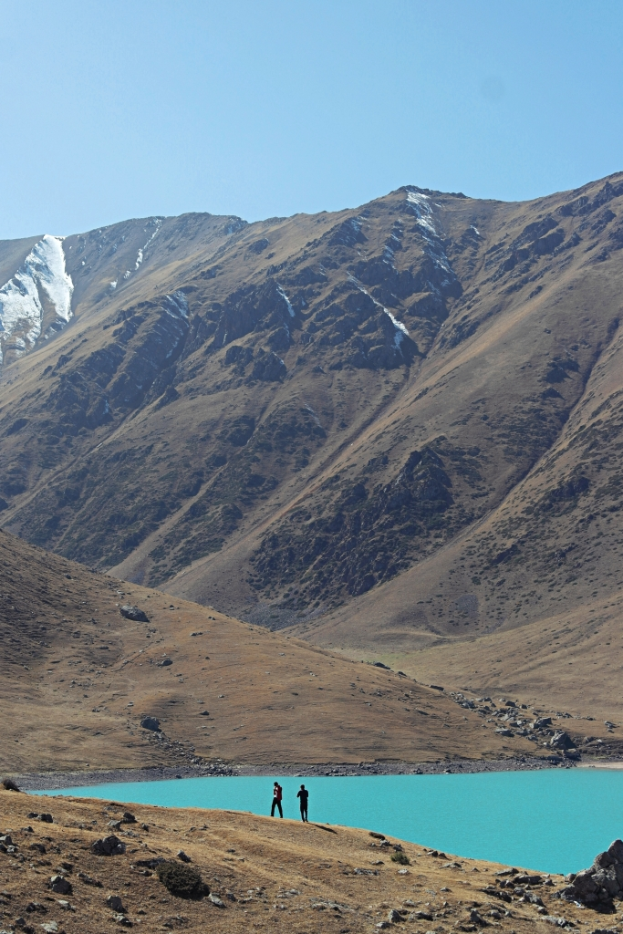 Kol-Tor lake Kyrgyzstan man and the mountain