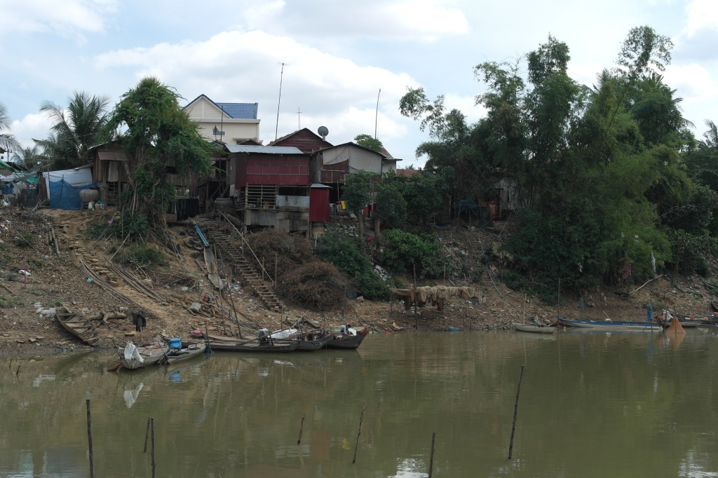 dirty riverside in cambodia