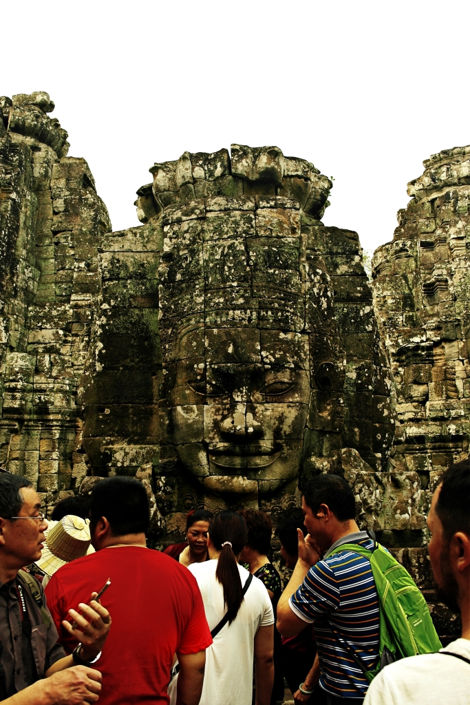people and human face statue in sieam reap angkor wat temple